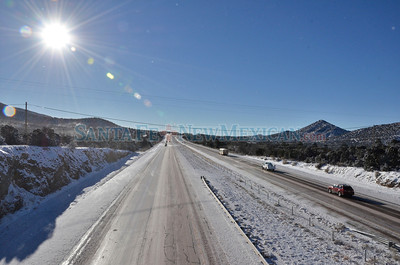 Motorists make their way along a snow and ice covered I-25 north of Old Pecos Trail on a very cold Monday morning, December 10, 2012.  Clyde Mueller/The New Mexican