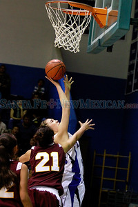 St. Michael's Alexa Chavez, #24,goes up for two point while Santa Fe Indian School, Ashley Terry #21, tries to retrieve  during the second quarter of their game at St. Michael's on Saturday, February 11, 2012.  Photos by Jane Phillips/The New Mexican