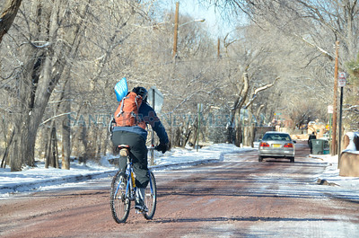 A bicycle rider makes his way along a snow covered Acequia Madre Wednesday, February 15, 2012 in Santa Fe, New Mexico. The weather caused some icy roads and a two-hour delay for Santa Fe schools.   Clyde Mueller/The New Mexican