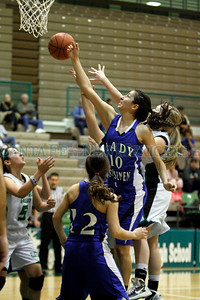 St. Mike's Rene Rivera, number 10, tries to recover her own rebound during the second quarter of the Pojoaque Valley High School vs St. Michael's High School on Feb. 21, 2011, at Pojoaque.   Photo by Luis Sánchez Saturno/The New Mexican