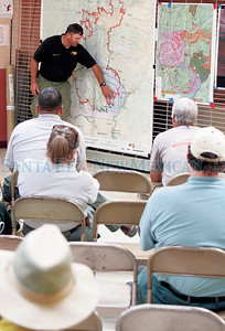 Jason Clawson-Operation Section Officer from AZ speaks during an  Incident Command Meeting at Cochi Elementary School on Tuesday, July 5, 2011. Photos by Jane Phillips/The New Mexican