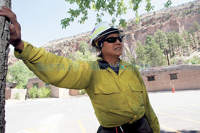 Lucy Padilla, 47, mother of four and from Santa Clara Pueblo has been a firefighter for the past 10 years.  Padilla helps in cleaning up   during their temporary fire protection at Bandelier National Monumente  on Wednesday, July 6, 2011. Photos by Jane Phillips/The New Mexican