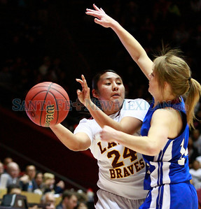 Justina Coriz (left), of Santa Fe Indian School girls basketball team, passes around Jordyne Young, of Lovington, during a championship game at the state basketball tournament at the Pit in Albuquerque, N.M. on March 9, 2012.  Photos by Natalie Guillén/The New Mexican