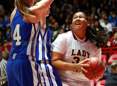 From left, Cori Haley and Bianca Walker, of Lovington, try to block Bridget Lee (right), of Santa Fe Indian School girls basketball team,  from shooting during a championship game at the state basketball tournament at the Pit in Albuquerque, N.M. on March 9, 2012.  Photos by Natalie Guillén/The New Mexican