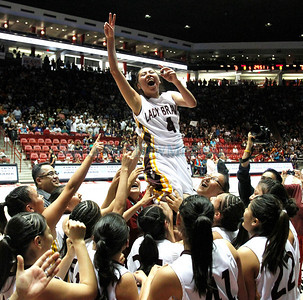 LEDE Santa Fe Indian School's girls basketball team hoists Jenine Coriz into the air as they beat Shiprock High School during the state girls basketball championship game at the Pit in Albuquerque, N.M. on Mar. 11, 2011. Natalie Guillén/The New Mexican