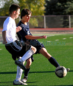 From left, Capital HIgh #9, Erik Munoz and Santa Fe High#5, the ball during the second quarter of their game at Capital High school on Saturday, October 22, 2011. Capital won 2-0. Photos by Jane Phillips/The New Mexican