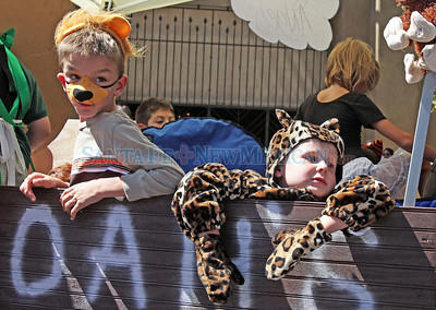 (L-R) Gabriel McMahom, 7, and Nathaniel Sternenberg, 4, join a float with Santo Nino, made to look like Noah's Ark, during the Historical/Hysterical parade on Sunday, Sept. 12, 2010 in Santa Fe, N.M..  Natalie Guillén/The New Mexican