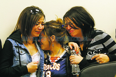 "From left, Monica Gettler, Trisha Valdez and Andrea Suazo console each other during a press conference in Rio Arriba County Sheriff's Office  in Española for their father, Joseph Valdez,47, who was killed ""execution style"" with Matthew Maestas, 53, on Monday in Hernandez.  Jane Phillips/The New Mexican"