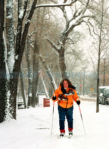 After taking a cold winter walk in several inches of new snow Santa Fe resident, Jenny Albert decided to  put on her cross country skies and ski up the sidewalk along East Alameda early Tuesday moring, December 26, 2000. Photo by Clyde Mueller photodaily/a1