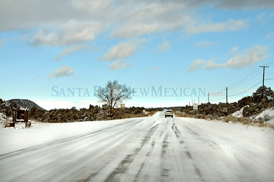 Snow storm and icy roads cancels SF public school, downs power lines and causes power outages to thousands of SF residents.  Clyde Mueller/The New Mexican