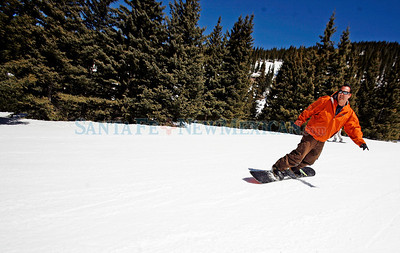 Shannon Hakeem, from Cerrillos, takes a run at Ski Santa Fe on April 10, 2010. The ski season is coming to an end after inpressive season with 165 skier days and total snow fall of about 260 inches. Sunday is the last day and an all day ticket costs $45.            Luis Sanchez Saturno/ The New Mexican.