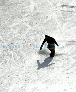 A man snowboards during the opening day at Ski Santa Fe on Dec. 11, 2009. The mountain opened with 85% of the lower mountain. The top half could open if the next storm is as big as the previous one. Lift tickets are at a discount rate. $45 adult, $40 teen, $35 senior and child and $34 half day.             Luis Sanchez Saturno/ The New Mexican