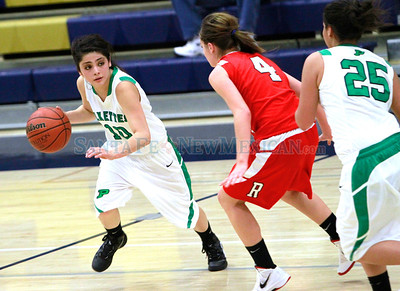 Pojoaque Valley Amber Roybal, 10,looks to pass the ball to teammate Gabrielle Gonzales,24, while Las Vegas Robertson, Abby Bradley, #4, looks to intersect   during the  Capital City Invitational at the Toby Roybal Gymnasium on Thursday, December 8, 2011. Robertson won 54-52 Photos by Jane Phillips/The New Mexican