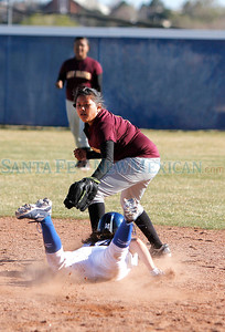 Santa Fe Indian School  Tafoya, #8 tries to tag  St. Michael's  Erin Torrez #14 at second base during their game at  Christian Brothers Athletic Complex on Wednesday, April 4, 2012.  Photos by Jane Phillips/The New Mexican