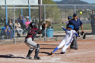 St. Michael's Viola Pecos, #7 slides into home plate while Santa Fe Indian School catcher Lena Martinez tries to tag her out during their game at St. Michael's at Christian Brothers Athletic Complex on Wednesday, April 4, 2012.  Photos by Jane Phillips/The New Mexican