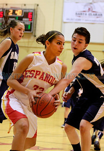 Española Lilly Martinez, #33 retrieves the ball while Santa Fe High Jackie Martinez, #23 tries to defend during their game at Edward Medina Gymnasium on Friday, February 24, 2012.  Photos by Jane Phillips/The New Mexican