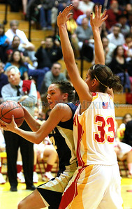 Santa Fe High Kayla Herrera, #12, looks to pass the ball while Española Lilly Martinez, #33, defends during the second quarter of their game at Edward Medina Gymnasium on Friday, February 24, 2012.  Photos by Jane Phillips/The New Mexican