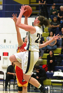 Santa Fe High Sabrina Lozada Cabbage, #25, goes up for two points while Española Lauren Quintana, #22 tries to defend during the second quarter of their game at the Toby Roybal Gymnasium on Tuesday, January 22, 2013.  Jane Phillips/The New Mexican