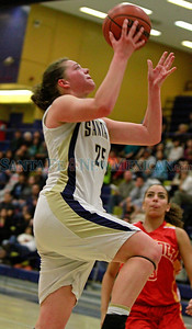 Santa Fe High Sabrina Lozada Cabbage, #25 goes up for two points in the first quarter of their game against Española at the Toby Roybal Gymnasium on Tuesday, January 22, 2013.  Jane Phillips/The New Mexican