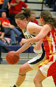 Santa Fe High Sabrina Lozada Cabbage, #25, dribbles around Española Lauren Quintana, #22 during the first quarter of their game   at the Toby Roybal Gymnasium on Tuesday, January 22, 2013.  Jane Phillips/The New Mexican