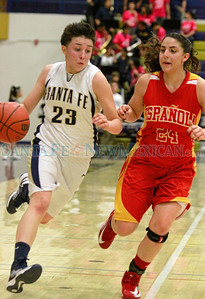 Santa Fe High Jackie Martinez #23,dribbles down court while Española, Alexis Lovato Gurule #24 tries to retrieve  during the second quarter of their game at the Toby Roybal Gymnasium on Tuesday, January 22, 2013.  Jane Phillips/The New Mexican