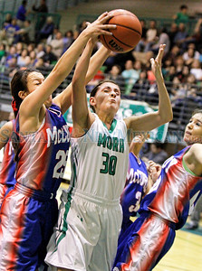 Mora vs McCurdy during the semifinals of the Northern Rio Grande Tournament at the Ben Lujan Memorial Gymnasium on Friday, January 3, 2014. Mora won 63-42.  Jane Phillips/The New Mexican