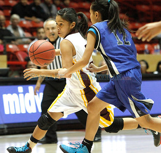 """Victoria Lovato (left), of Santa Fe Indian School, breaks past Krishia Artieda (right) of Navajo PIne during a girls basketball game at the Arthur """"DINTY"""" Romero Basketball Tip-Off Classic held at the Pit in Albuquerque, N.M. on Nov. 18, 2011.  Natalie Guillén/The New Mexi"""