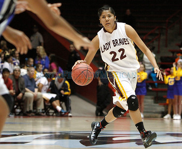 """Jasmine Felipe, of Santa Fe Indian School, brings the ball down the court during a girls basketball game against Navajo Pine at the Arthur """"DINTY"""" Romero Basketball Tip-Off Classic held at the Pit in Albuquerque, N.M. on Nov. 18, 2011.  Natalie Guillén/The New Mexican"""